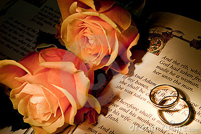 Wedding Rings On A Bible With The Genesis Text Thumb